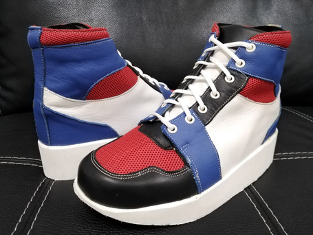 Black, blue, white and red leather boots with red mesh and white sole