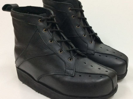 Black boots with hole punch detail