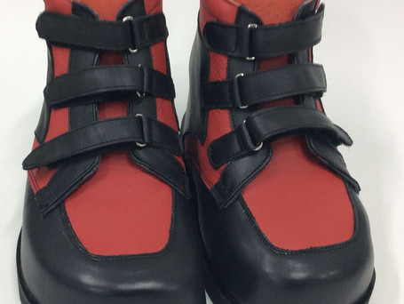 Black and red leather boots with triple velcro