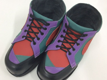 Black, purple, teal and red boots