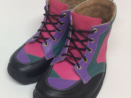Green, pink, purple and black leather boots