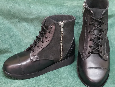 Black boots leather with brogue detail