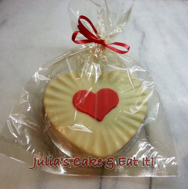 White chocolate heart filled with chocolate truffle cake.