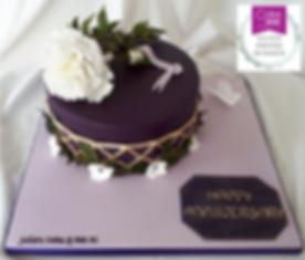 Deep purple anniversary cake with beautiful white peony
