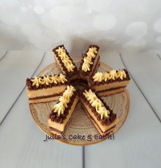Vanilla sponge slices with chocolate buttercream and white chocolate ganache.