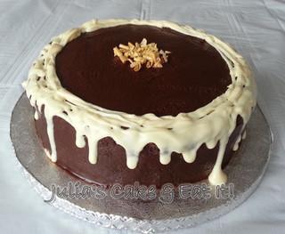 Dark chocolate fudge cake with drippy white chocolate and golden chocolate curls