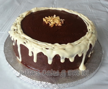 Dark chocolate fudge cake with drippy white chocolate and golden chocolate curls