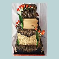 Black & Gold wedding cake with freesias