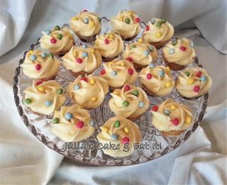Mini vanilla cupcakes with vanilla buttercream and chocolate polkadots