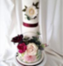 burgundy + cream hoop cake with hand painted base tier