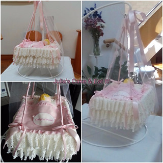 Vanilla sponge hanging cradle cake with white chocolate ganache filling and edible lace