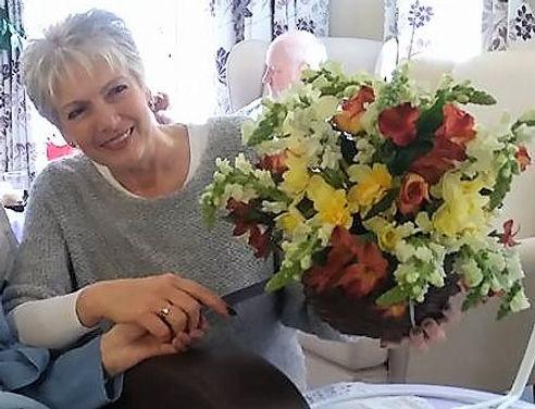 Julia May with hangin basket cake