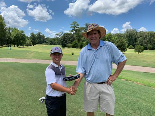 L to R: Boys C 12-13 John Markow (4th) & Greg Brooking (Natchez Golf Club Pro) — at Natchez Golf Club.