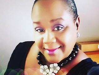 Vastina Omosebi designer/owner of Omosebi Jewelry Designs wearing one of her custom designs.