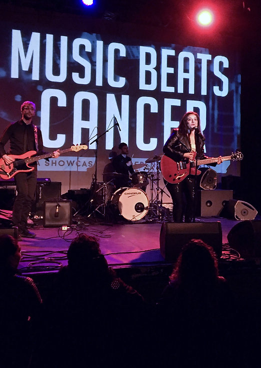 Sinem Saniye performing onstage at Music Hall Of Williamsburg for Music Beats Cancer