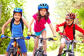 Portrait of three little cyclists riding