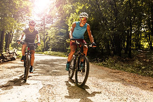 Two mountain bikers riding bike in the f