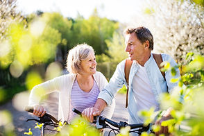 Beautiful senior couple with bicycles ou