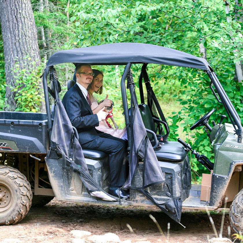 Bride and Groom in four-wheel drive vehicle