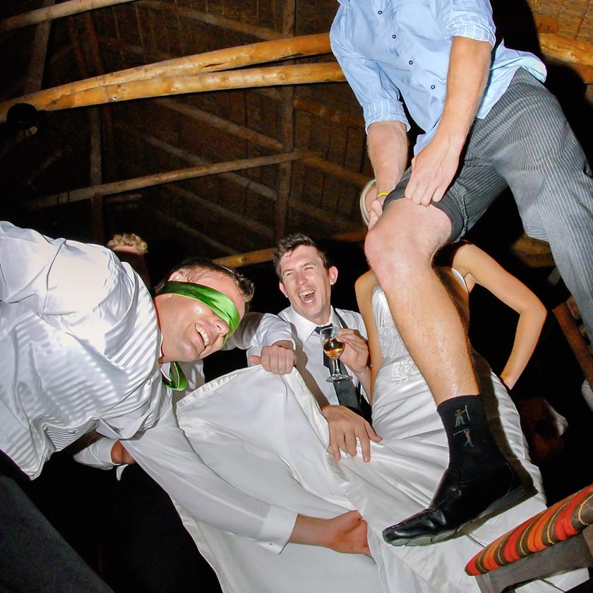 Groom taking brides garter off