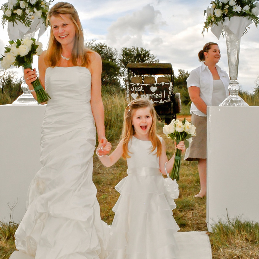 Bride and flower girl in white dresses
