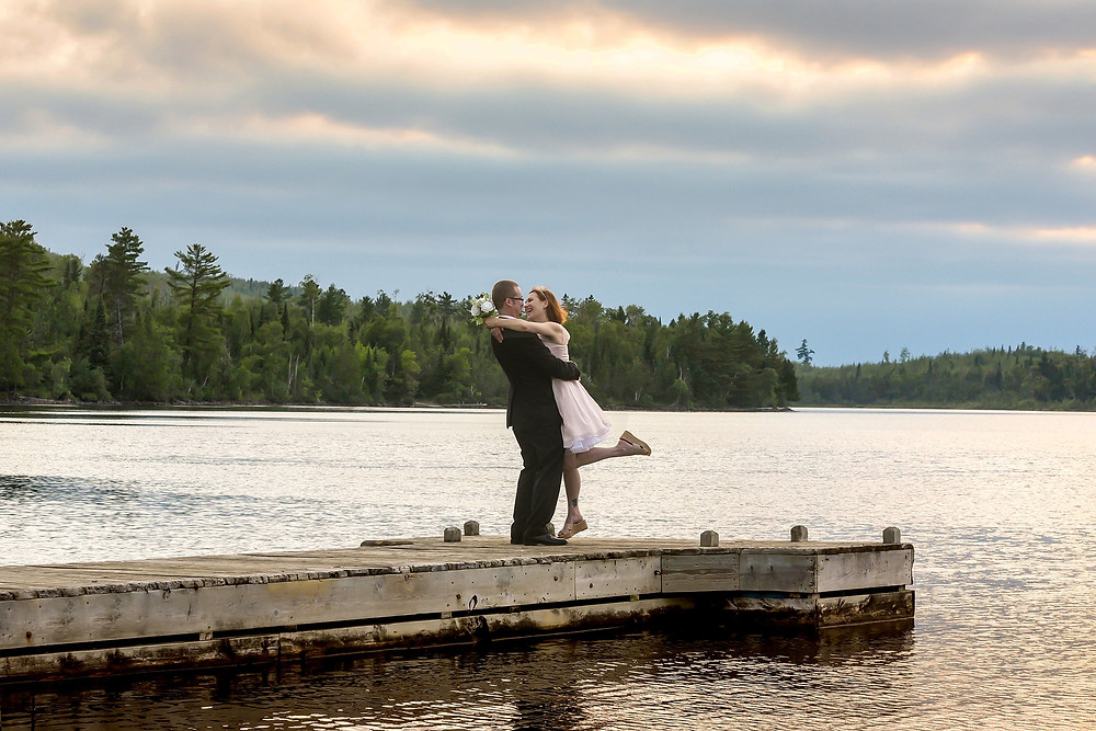 Bride & Groom hugging on dock on a lake