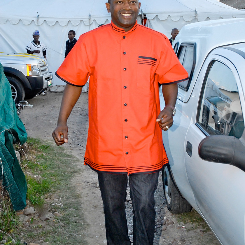 Man in Red Shirt at Traditional Xhosa Wedding in Port Elizabeth South Africa