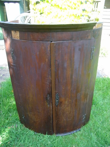 poor condition of antique corner cupboard