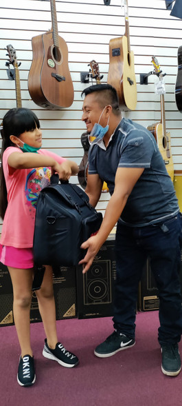 Father giving daughter a new accordion.