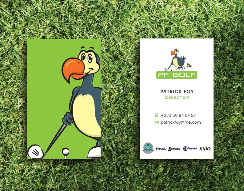 Business cards PF Golf laying on grass