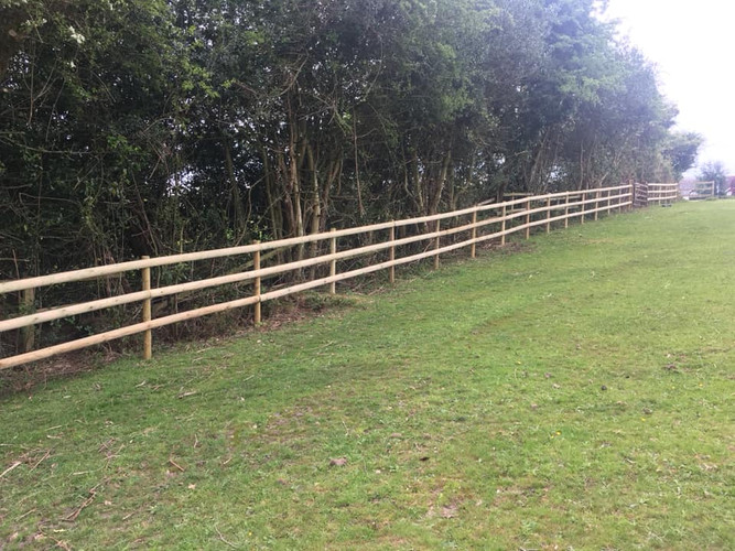 Round post and rail fencing