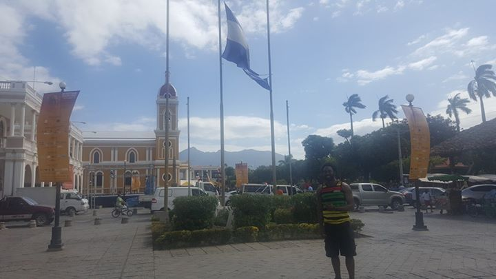 American guy, wearing a Jamaican shirt (bought in Montego, JA) standing under a Nicaraguan flag