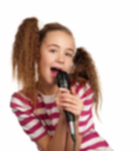 Portrait of girl singing with microphone