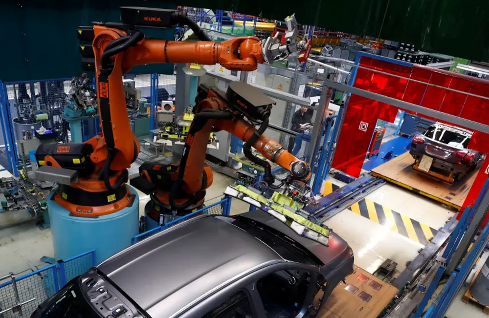 A robot engineered by Kuka adjusts a windscreen in a fully automated process on a model of the A-class production line of German car manufacturer Mercedes Benz at the Daimler factory in Rastatt, Germany, February 4, 2019. Picture taken on February 4, 2019. (photo credit: REUTERS)