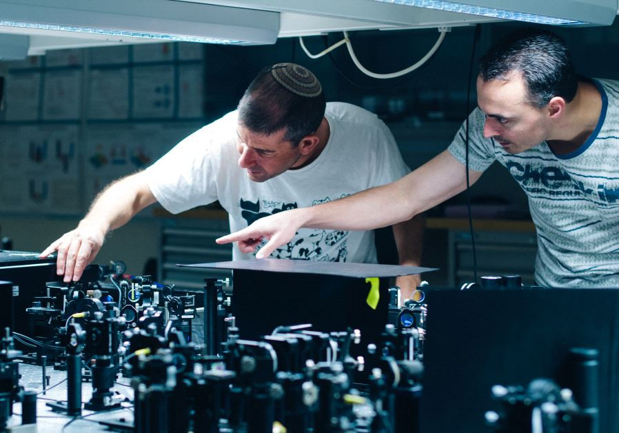 Prof. Hagai Eisenberg and graduate student Daniel Istrati study a single photon experiment at the Hebrew University's Quantum Information Science Center. (Photo Credit: Yitz Woolf for Hebrew University)