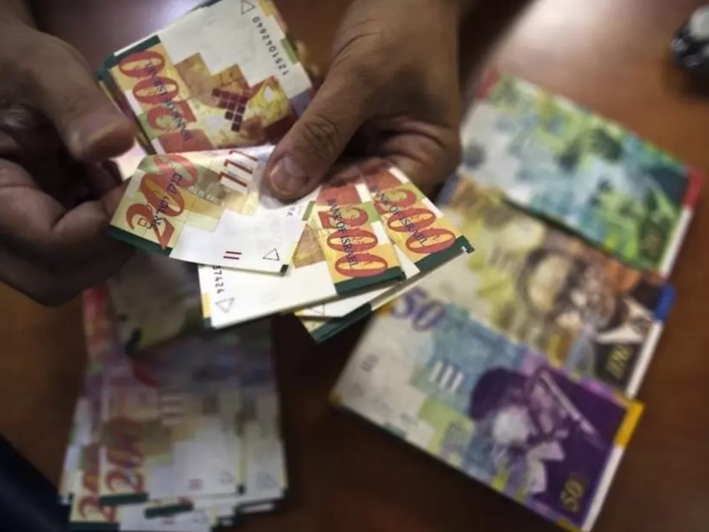 Shekel money bills. (photo credit: REUTERS)