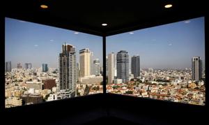 A general view of Tel Aviv's skyline is seen through a hotel window in Tel Aviv (photo credit: REUTERS)