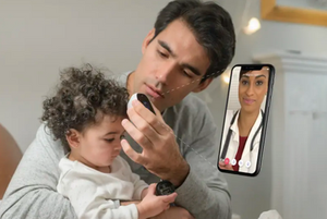 Father using Tyto Care device to take daughter's temperature. (photo credit: TYTO CARE.)