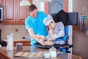 helping disabled son bake cookies.jpg