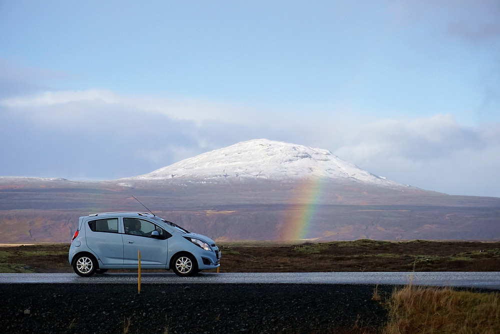 Snow mountain, rainbow, and a moving car~!