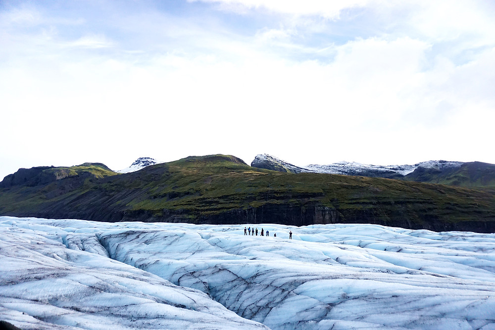 Group pass by the great glaciers.