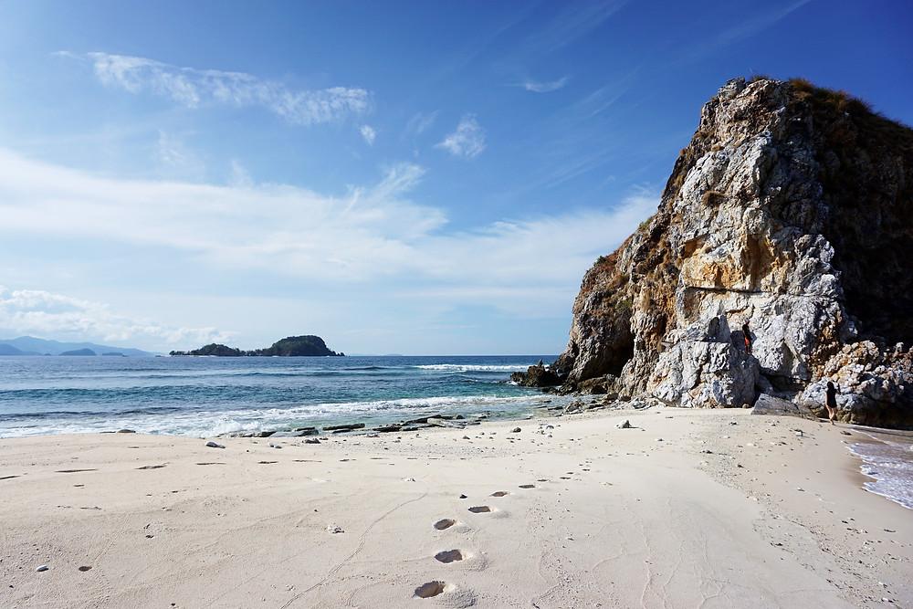 Footprint toward the limestone cliff.