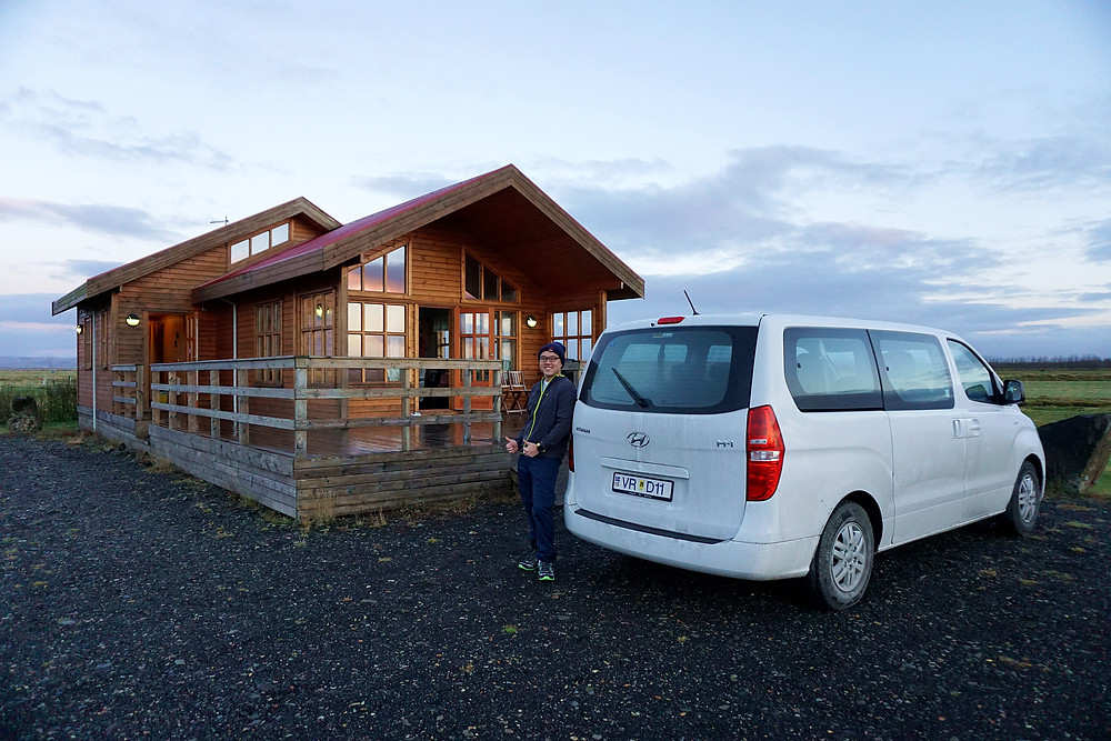 Me with the cottage, and our car.
