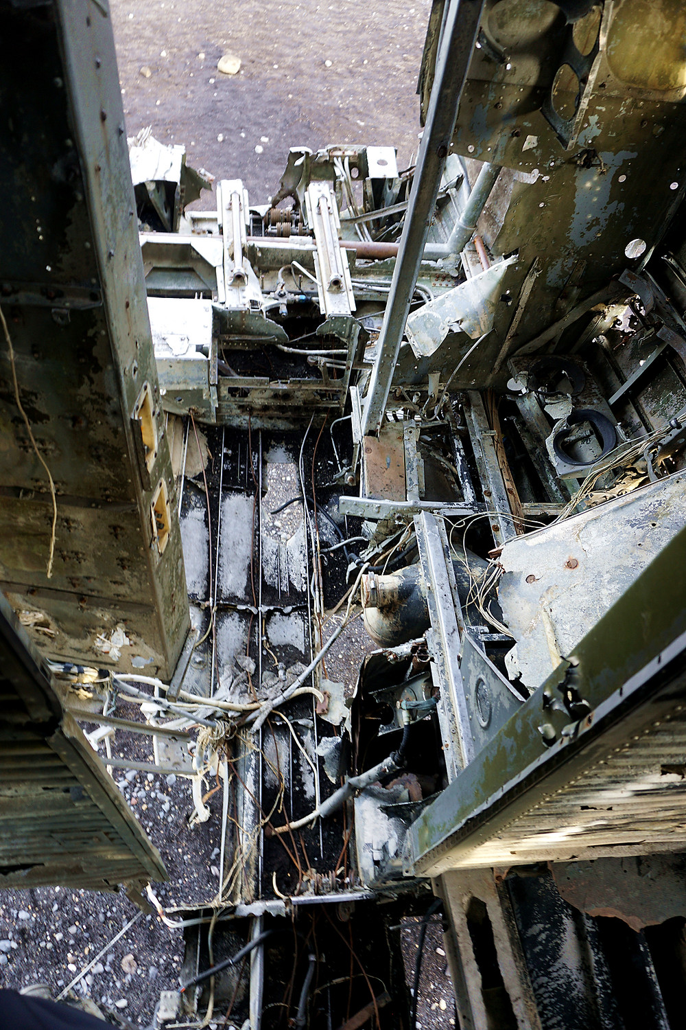 Around the cockpit of the crashed plane.