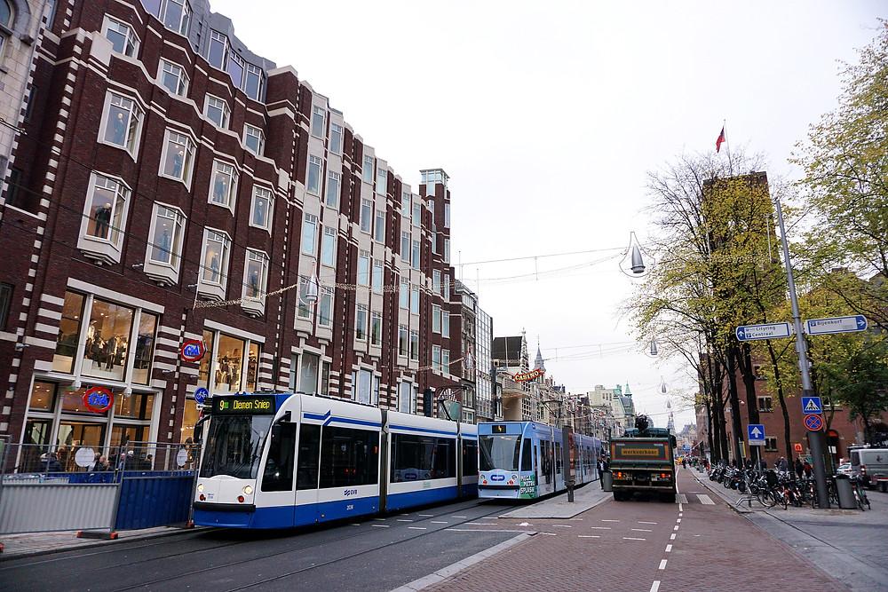 Tram in Damrak street.