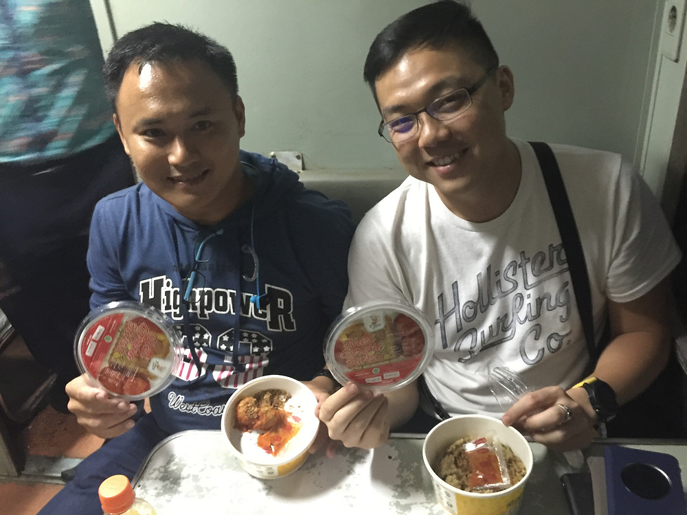 Me and John with our light dinner meal on Sri Tanjung train.