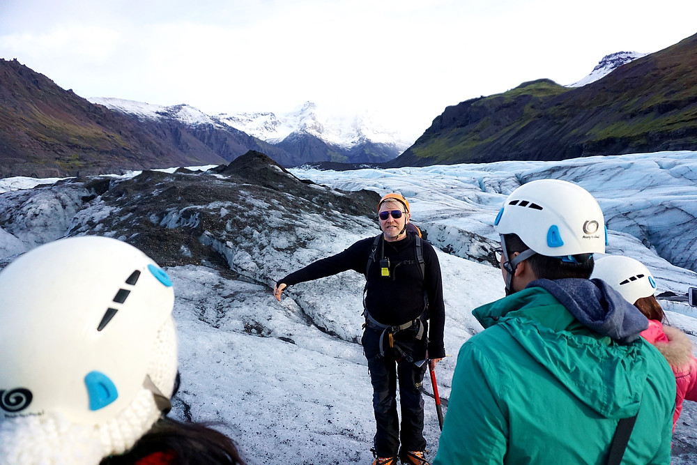 Tour guide telling us history about the glaciers.