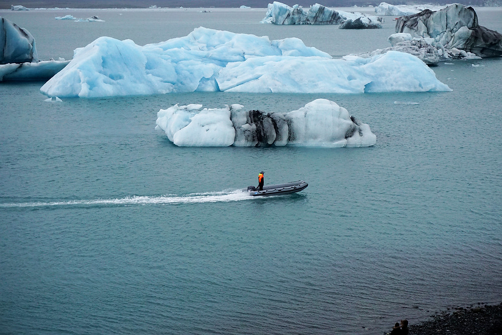 A boat cruise by iceberg on the lake.