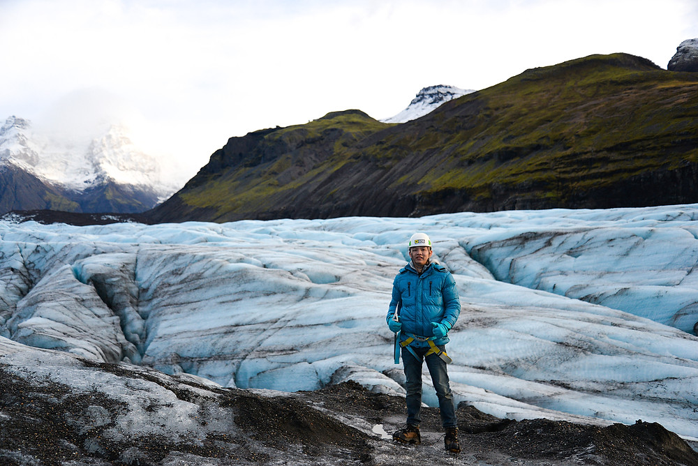 Jenson standing on glaciers. - Photo credited to Hybrid.