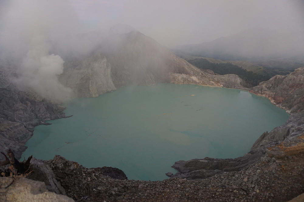 First peek towards Kawah Ijen lake in a brief sunlight.
